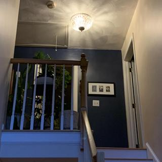 From front entrance at bottom of stairs.