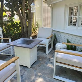 I decided to paint my fire pit table white to match my chairs.