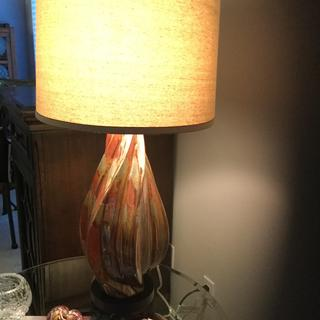 With a 60 watt bulb....I believe I will buy a higher wattage to show more of the detail of the lamp.
