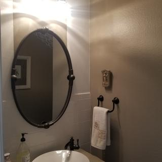 With lights on, low light. Can't put on makeup with this light, but very nice ambiance for 1/2 bath