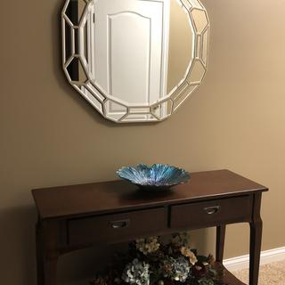 Very nice table, Easy to put together also got the mirror from Lamps Plus