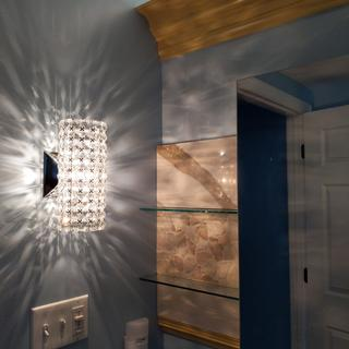 One Cesenna sconce at each e end of vanity, great accent when dimmed.