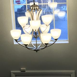 I love this chandelier in my entry! My only complaint is that one of the top tier lights is crooked.