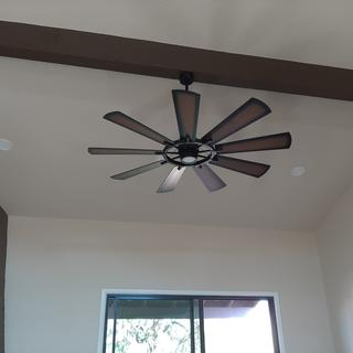 15 foot ceilings and attached to wood beam.