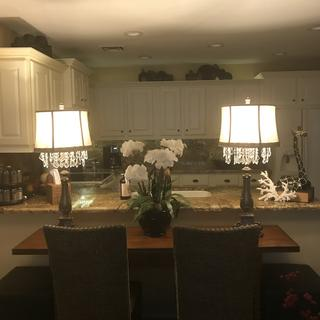 Lamps on table, sits in front of my kitchen. That table turns into dining table when we want. Condo
