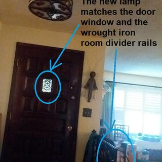 The Lamps Plus light matches the window in my front door and the metal rails.