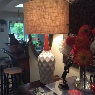 Rocco lamp looks elegantly Mid-Century. The cat in the basket adds to the charm.