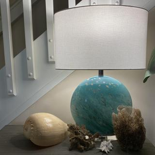 As functional as it is beautiful! Mixes so well with my beach collection on my downstairs cabinet.