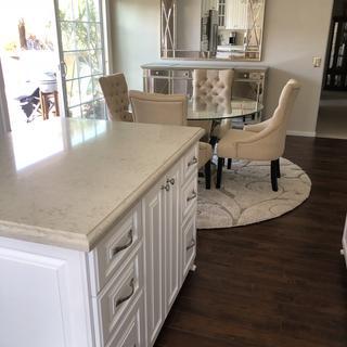 Piece de resistance of dining room and kitchen.  Exquisite chandelier.