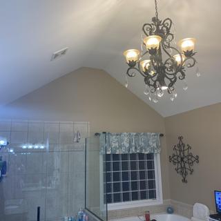 Love love love this chandelier!! It looks wonderful in our bathroom!