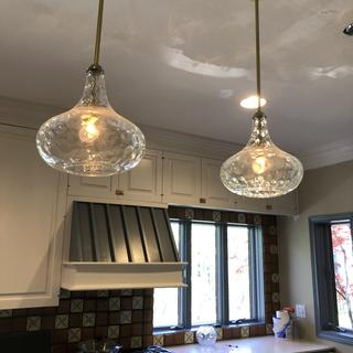 Love these pendants. The clear globes keep the space feeling open and airy.