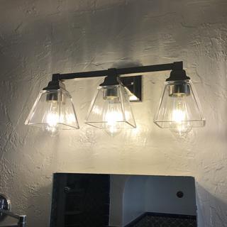 Perfect lighting over bathroom mirror.