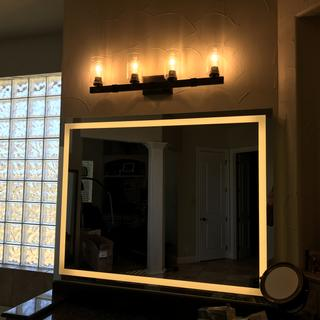 Fits nicely over a mirror, can be mounted with bulbs up or bulbs down.