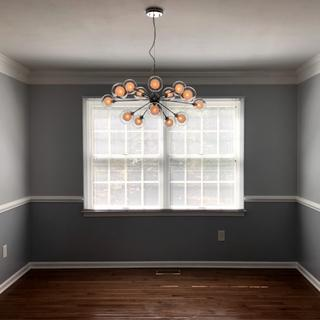Installed this fixture in our newly painted dining room.  This photo shows the fixture bulbs dimmed.