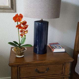 Beautiful lamp. Navy ceramic  base has a slight texture which blends with  the gray shade.