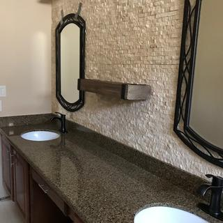 These mirrors look awesome with the antique bronze faucets.