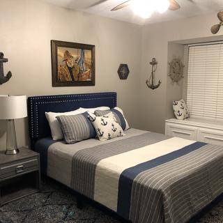 Nautical Room with glass and metal lamp