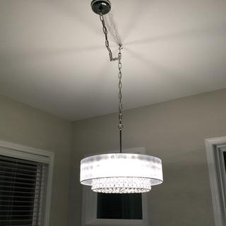 We swagged  it over our dining table, did not feel it was a $500 light but liked it