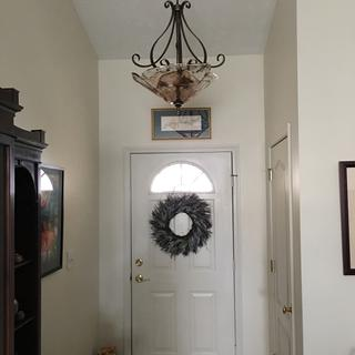 New entryway pendant light without the lights on.