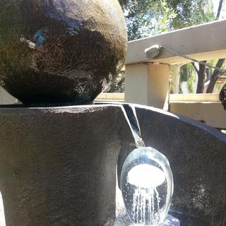 Fountain with jelly fish paper weights on inverted glasses