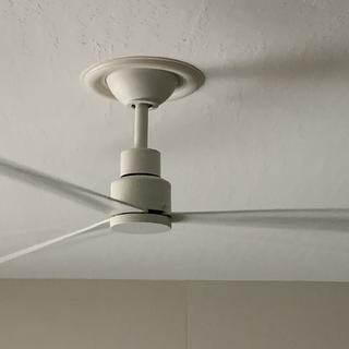 Ceiling fan with my added trim ring to cover gap between old recessed lighting hole and fan canopy