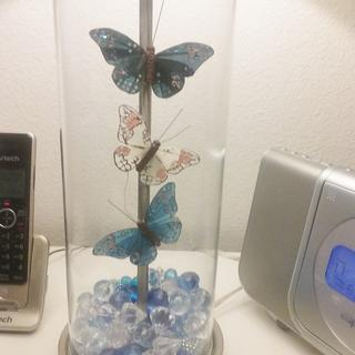 I filled the lamp with acrylic jewel pieces and attached the butterflies with a little fun tac.