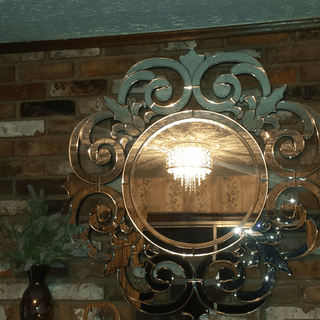 "Corina crystal light reflected in Lamps Plus ""calla""mirror????"