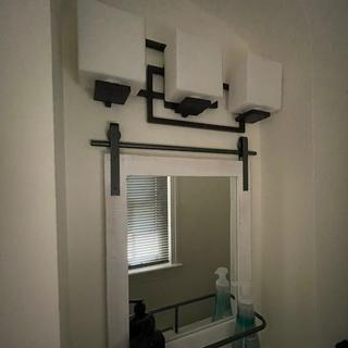 I love my new fixture.  It fits perfectly in my powder room