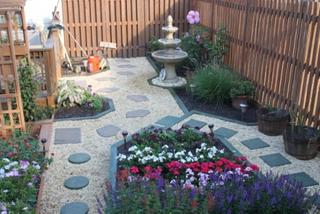 fountain is centered to side of deck, one section of planting not complete