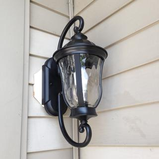The Francis 19 1/4 inch High Oil Bronze Outdoor Wall Light at the front door  of my townhouse.