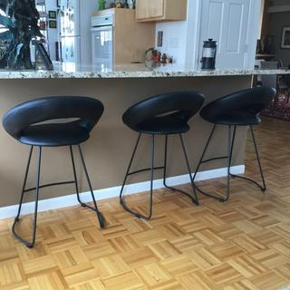 Possano 23 inch Black Faux Leather Counter Stool.