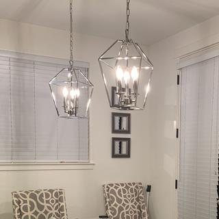 Beautiful chrome finish and elegant design. The size fits perfectly in my dining room.