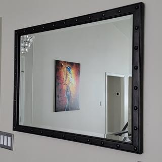 Sturdy and well built and beautiful entryway mirror.