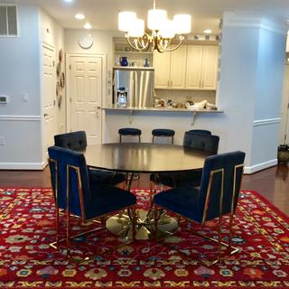 Dining area, chandelier over table with curved brass base