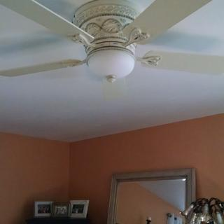 Bedroom ceiling fan with light off.