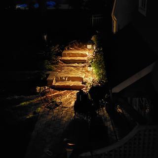 "night time view of Case Seville 28"" Dark Walnut LED Path Light."
