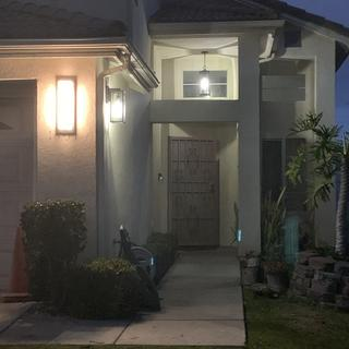 Front entry lighting at nighttime.