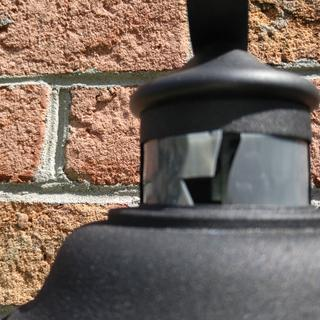 Cracked plastic collar piece surrounding motion sensor.
