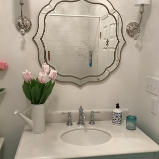 We LOVE our scalloped mirror!!  It creates a beautiful elegance In our newly renovated bathroom.