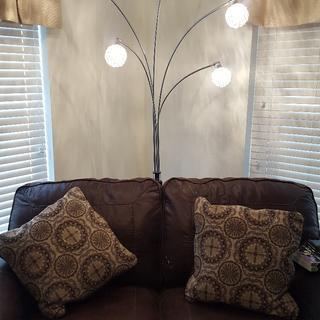 Lamp installed behind loveseat
