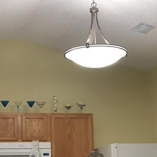 Kitchen- replaced long ceiling fixture. Also installed dimmer switches because it is bright.