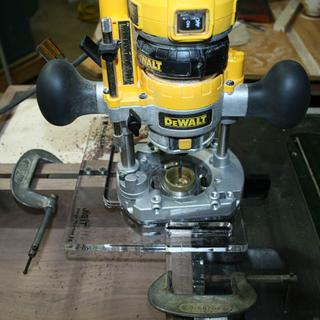 Using a small DeWalt plunge router.