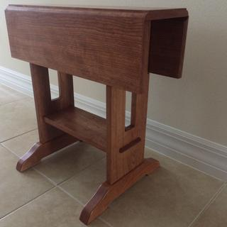 "This is a drop leaf cherry end table. It measures 24"" h x 24"" l  x 8"" w closed and 24"" w open."