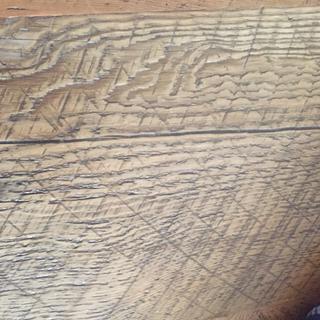 Repaired crack in repurposed barnwood table