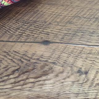 Repaired crack in repurposed barn wood table