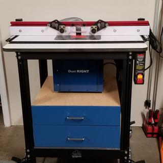Jessem router table With Rockler Dust Right and shop-built accessory cabinet.
