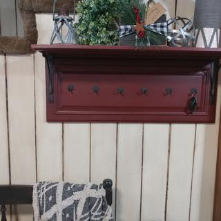 Van dyke brown over maroon on shelf. Also over an off white on solid wood paneling