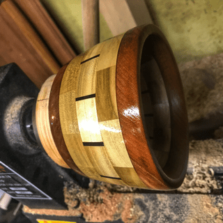 A laminated  cross cut laminated bowl that I turned with my lathe and sorbys