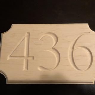 A house numbers sign.