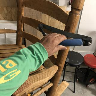 Sanding rocking chair using bow sander.